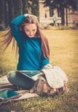 Student girl in a city park Royalty Free Stock Photography