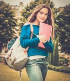 Student girl in a city park Stock Images