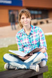 Student girl with copybook on bench. Summer campus Stock Image