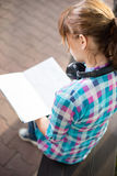 Student girl with copybook on bench. Summer campus. Student girl with copybook on bench outdoor. Summer campus park. Studying to exam Royalty Free Stock Photos