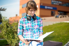 Student girl with copybook on bench. Summer campus. Student girl with copybook on bench outdoor. Summer campus park. Studying to exam Royalty Free Stock Photography