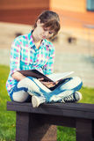 Student girl with copybook on bench. Summer campus. Student girl with copybook on bench outdoor. Summer campus park. Studying to exam Stock Photos