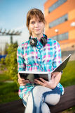 Student girl with copybook on bench. Summer campus Royalty Free Stock Image