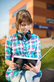 Student girl with copybook on bench. Summer campus park. Stock Image