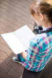 Student girl with copybook on bench. Summer campus park. Student girl with copybook on bench outdoor. Summer campus park. Studying to exam Royalty Free Stock Photo