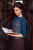 Student girl does notes in the notebook. Royalty Free Stock Photography