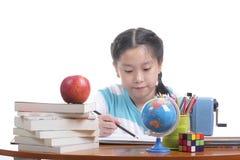 Student girl doing homework Stock Photo