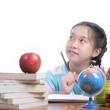 Student girl doing homework Stock Images
