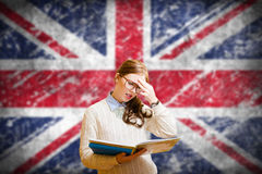Student girl on english union jack blurred. Picture of young woman in glasses and sweater holding files. Student girl on english union jack blurred background Royalty Free Stock Image