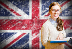 Student girl on english union jack blurred Royalty Free Stock Image