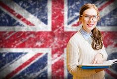 Student girl on english union jack blurred royalty free stock image