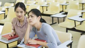 Student girl feel sleepy in the classroom. The student girl feel sleepy in the classroom Royalty Free Stock Photos