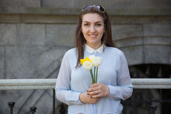 Student girl with flowers in summer day Royalty Free Stock Photo