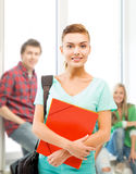 Student girl with folders and school bag Royalty Free Stock Image