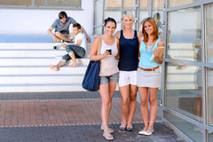 Student girl friends smiling front of college Royalty Free Stock Photography