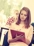 Student girl in front of her mates in classroom royalty free stock photos