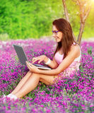 Student girl in the garden Royalty Free Stock Photography