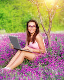 Student girl in the garden Royalty Free Stock Image