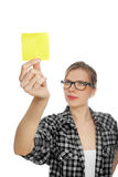 Student girl with glasses takes a yellow note Stock Images