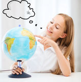 Student girl with globe at school Royalty Free Stock Image