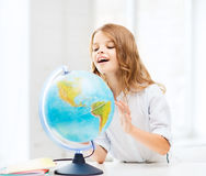 Student girl with globe at school Stock Photo