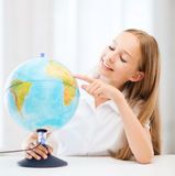 Student girl with globe at school Royalty Free Stock Photo