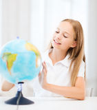 Student girl with globe at school Royalty Free Stock Images