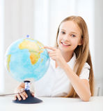 Student girl with globe at school Royalty Free Stock Photography