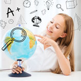 Student girl with globe at school Royalty Free Stock Photos