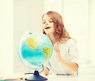Student girl with globe at school Stock Images