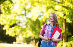 Student girl going back to school and smiling. Student girl outdoors going back to school and smiling Royalty Free Stock Image