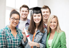 Student girl in graduation cap with diploma Royalty Free Stock Photo