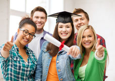 Student girl in graduation cap with diploma Royalty Free Stock Photography
