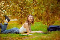 Student girl on  grass with a computer Stock Image