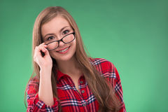 Student girl on green background Stock Photography