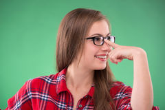 Student girl on green background Stock Photo
