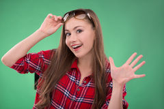 Student girl on green background Royalty Free Stock Photography