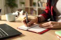 Free Student Girl Hand Writing On Agenda In The Night Stock Photography - 179946872