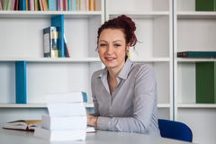 Student girl happy posing in the library Stock Image