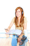Student girl with headphones Stock Photo
