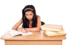 Student girl at her desk Royalty Free Stock Photography