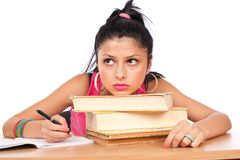 Student girl at her desk Royalty Free Stock Photos