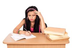 Student girl at her desk Royalty Free Stock Image