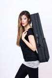 Student girl with her instrument case. Sweet student girl with her instrument case Stock Image