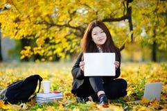 Student girl holding blank whiteboard in her hands Stock Photo