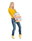 Student girl holding heavy stack of books Stock Image