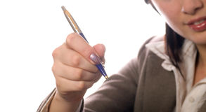 Student girl holding a pen Stock Image