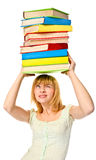 Student girl holding stack color books over the head. Isolated Stock Image
