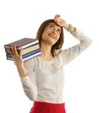 Student girl holds stack of books in hands Royalty Free Stock Photo