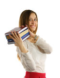 Student girl holds stack of books in hands Royalty Free Stock Image